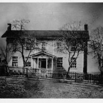 "Image of Chang Bunker Home - Home of Chang and Adelaide Bunker in White Plains, where their daughter, Lizzie, and Caleb Haynes were married on January 10, 1889.  This picture was taken before the house was remodeled by future owners.  Note on back of picture says, ""Credit Caleb Hill."""