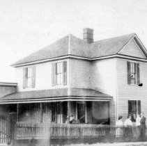 Image of Creveling Family - House at south corner of Rawley Ave. & Main Street, Mount Airy, now demolished.  C. C. Creveling, with his wife and daughter Dorothy are in the yard.