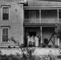 Image of W. A. Campbell House - W. A. Campbell House. 145 Elm Street. ca 1916. Burned down in 1930's. Note on photo: Gus and Mary Etta with their five girls on the porch.  Only son, Clayron, missing.