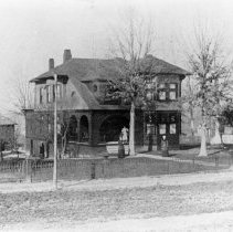 Image of Thomas Fawcett House - Thomas Fawcett House. North Main Street. Mount Airy. Shingle-style house ca 1895.  A wrought iron fence surrounds the building, and several women can be seen in the yard.