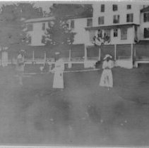 Image of Croquet Game - Croquet game at White Sulphur Springs, a popular resort near Mount Airy.  Two women and a man are in the foreground, hotel is in the background.