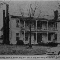 """Image of Elisha Banner House - Elisha Banner House, South Main Street, Mount Airy.  (later Webster).  Notation at bottom of picture reads: """"The oldest house in Mount Airy was once a stop for weary stagecoach travelers. """""""