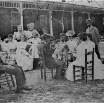 Image of White Sulphur Springs - Old White Sulphur Springs Hotel, with several guests on the lawn.  One group is playing cards.