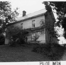 Image of Irvin Reid House - Irvin Reid House, Pine Street between Davis and Academy Streets, Pilot Mountain.  Built ca. 1900.  For more information see SIMPLE TREASURES page 203 and state record 648.