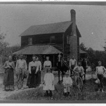 Image of Charles Wesley Ray House - Charles Wesley Ray House, SR 1001, Poplar Springs, built ca. 1893.  A number of people, also two horses and a bicycle, are in the front yard.  For more information about the house, see SIMPLE TREASURES page 88 and state record 538.