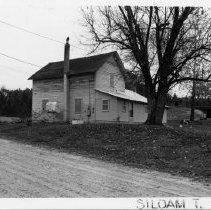Image of Reeves Store and Post Office - Reeves Store and Post Office, Siloam, North Carolina.  The brothers Richard Elwell and Micajah Coke Reeves shared a homestead overlooking the Yadkin River in Siloam.  Together they operated a large farm of over one thousand acres and under the firm name of R. E. &  M. C. Reeves, they ran a general store/post office, a mill, and a tobacco factory about a half mile north of their home. Of these three enterprises, only the store building remains.
