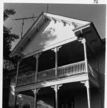 Image of Aaron Whitaker House - Aaron Whitaker House, SR 2081 Siloam, close-up view of two-story porch.  For more information see SIMPLE TREASURES page 245 and state record 194.