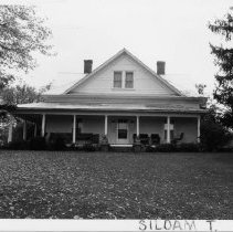 Image of Riley Fulk House - Riley Fulk House, SR 2080, Siloam Township, built in 1921 by carpenters Jasper and Elmer Patterson for Filey W. and Louvicie (Shore) Fulk.  For more information see SIMPLE TREASURES pate 243 and state record 179.