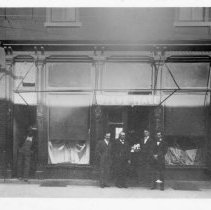 Image of Hale Clothing Store - S. M. Hale Clothing Store. North Main Street. Mount Airy. S. M. Hale and Will Hale in doorway flanked by two employees (unknown). Currently Holcomb Hardware.  The back of the picture has also been copied to aid in research.