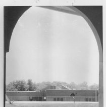 Image of Elkin Primary School - Elkin Primary School, Elkin.  Caption on back of picture reads: Elkin's new primary school seen through the arched cupola of the old one, which was demolished in 1975.