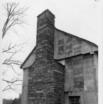 Image of Bray House - Bray House, SR 2227, Copeland vicinity, probably built late 18th century/early 19th century, a log structure now sheathed with corrugated sheet metal.  For more information see SIMPLE TREASURES page 214 and State Record 239.