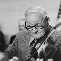 """Image of Tommy Jarrell - Photograph of Tommy Jarrell playing fiddle.  Caption on back says, """"Surry County String Band Music.  Tommy Jarrell today. """""""