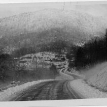 Image of Snow Scene - Photograph from the Bicentennial Book of Surry County of a snow scene of an icy roadway.  Photo located on page 49.