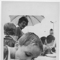 Image of Child Eating.  A photograph of this child (not the same as this image) can be found on page 83