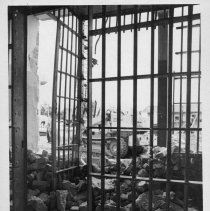 Image of Old Jail, Dobson - Old Jail, Dobson, during demolition.  Metal structures in foreground, heavy machinery in background.