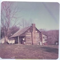 Image of Log House - Old Log house.  The following information is included on a separate paper:   March 4th, 1976.  The old house shown in these pictures was built by Phillip Deatherage, Born 29th. June 1822, Married to Martha Forkner in June 1840.  Built this story & 1/2 Log house same year.This old house is still oppipied (sic) and has been since it was built.  It is located App. 4 miles from Main St. Mt. Airy, on State Route 103 East.  One picture was made looking to the S.W. and the other looking to the S.E. it is one of the oldest houses still being occipied (sic) in Surry Co.  Pictures made by   Paola R. Puckett, Rt. 3, Box 19-A2 Mt. Airy (her signature)