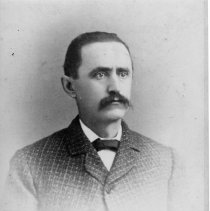 Image of Matthew Childs Moore - Matthew Childs Moore.  Photograph of a gentleman with mustache, wearing what appears to be a tweed suit with bow tie.