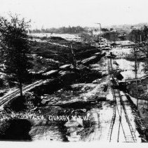 Image of Mount Airy Granite Quarry - Mount Airy Granite Quarry.  General view of quarry site which includes railroad tracks, buildings, and trees.