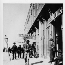 Image of Main Street, Mount Airy - Main Street, Mount Airy, looking north from Moore Avenue.  The Post Office, R. T. Joyce Hardware, and W. W. Burk... are on the right.  Several men, all wearing hats,  are walking, standing, or sitting along the sidewalk, and a horse and wagon can be seen in the background.