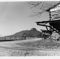 Image of Pilot Mountain - Pilot Mountain from the Shoals side.  An old log barn is in the foreground.