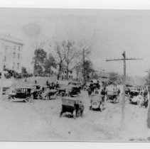 Image of Dedication of Courthouse - Dedication of courthouse in Dobson, 1916/1917.  The street is filled with cars, and a number of people are standing in the courthouse yard.  Taken by Grady Cooper from the porch of the Kenlin Hotel.