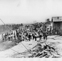 Image of Granite Quarry Workforce - North Carolina Granite Company, Mount Airy, workforce, about 1895.  Railroad spur into quarry area for moving blocks of granite.