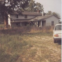 Image of Flinchum House - Flinchum House, near Pilot Mountain, print made 1984.  Building appears to be abandoned, and porch roof is falling down.