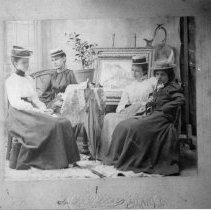 Image of Parlor Scene - Turn of century parlor scene.  Four ladies, Savannah S Primrose, Susan Calloway, Zella M. Dean, and Jettie H. Moore pose for portrait.
