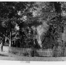 "Image of Jimmy Schaub House - Jimmy Schaub House, corner Main and Cherry Streets, Mount Airy.  Information on back of picture reads: ""Mount Airy News - Mar. 9, 1916, 'Mr. J. W. Schaub is having the old Schaub residence and workshop on the corner of Main and Cherry Streets torn down.  With its passing, one of the oldest landmarks of the town will be wiped out.'"""
