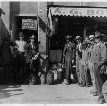 "Image of Prohibition - Mount Airy during Prohibition.  Note on back of picture reads: ""Prohibition.  Main Street Center, West side about where Cato's is.""  Another note reads: ""Northwestern side of the central business district.""  Several men are standing by a still in front of a sign which reads ""Sheriff's Office Upstairs"""