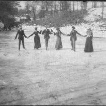 Image of Ice Skating - Ice skating near Mount Airy, early 1900s.  Three couples hold hands as they skate.