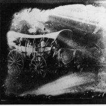 """Image of Covered Wagon - Covered wagon.  Notes on back of picture read: '""""Cousin Ben,' Sarah Slusher Creasy, Edith Sparger Creasy??  Size EH - Crop off 1"""" on left side Surry County - Patrick County wagon. Albert Creasy has negative."""""""