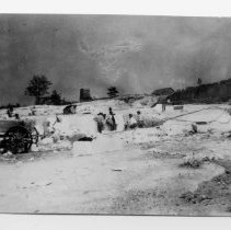 Image of Mount Airy Granite Quarry - Mount Airy Granite Quarry, 1907 or 1908.  A wagon is in the left-hand side of the picture, and several men are seen at work.