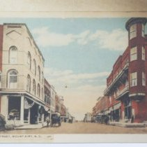 Image of Main Street, Mount Airy - Main Street, Mount Airy, looking south from Oak Street, about 1895.  Blue Ridge Hotel is on the right, a Hardware Store on left, with Dr. Hege's dentist office upstairs.  Several horses and wagons are on the street.  Picture is a copy of a post card.