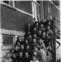 Image of Rockford Street School Student Body - Rockford Street School, Mount Airy, student body.  Students are seated on steps outside the building.  Several are identified on the back of the picture (back also copied to include this information).