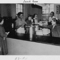 Image of Lunchroom, South Main Street School - Lunchroom South Main Street School, Mount Airy, 1953-54.  Lunchroom workers are serving several students.  There are no identifications.