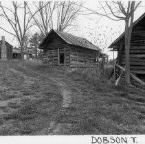 Image of Log Homestead - Log house with outbuildings in Dobson on Hwy. 601.   See SIMPLE TREASURES page 68 for more information.