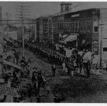 Image of Parade - Main Street, Mount Airy, looking north from Franklin Street.  The street is filled with marchers and band members, with a number of onlookers along the sides.