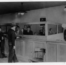 Image of Bank Interior - Bank interior, Mount Airy.  Several employees and customers are in the picture, including W. G. Sydnor, William Sydnor, John Folger, and B. F. Sparger.