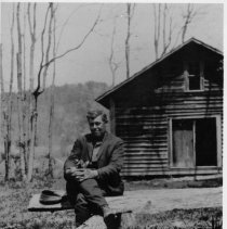 """Image of Chris Bunker - Chris Bunker at the old Mitchell's River Baptist Church.  Note on back of picture reads, """"The present site.  Not the original church near Kapp's Mill."""""""