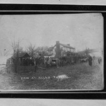 Image of Claude and Floyd Allen Funeral - Funeral for Claude and Floyd Allen at Floyd Allen house.   A number of people can be seen standing in the yard.