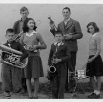 Image of Pilot Mountain Band Students - Six Pilot Mountain band students, early 1940s, with their instruments.  Left to right: John R. Truelove, Jimmy Gravitte, Tensie Needham, Patsy Gordon, ----- Barnes, Charles Matthews.