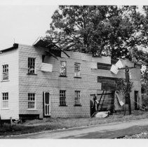 Image of Storm-Damaged Building - Partially destroyed building, thought to be on Depot Street, Pilot Mountain.  Building reflects storm damage.