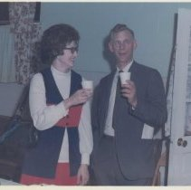 Image of Reverend Bill Edwards and Friend - Color picture of Reverend Bill Edwards and a lady, possibly Carolyn Boyles at some social function.  Reverend Edwards appears to be clowning around.  Pilot Mountain.