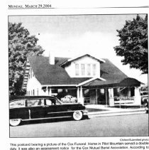 Image of Cox Funeral Home - Newspaper copy of a postcard picture of Cox Funeral Home, Main Street, Pilot Mountain, which served a double duty.  It was also an assessment notice for the Cox Mutual Burial Association.  According to the notice, the yearly assessment was $1.60 and a quarterly amount of 40 cents was due on the account when the notice was mailed in November of 1957.  Postage on the postcard was 2 cents.  From The Mount Airy News, March 29, 2004.  According to Mrs. Pansy Broughton, the funeral home was operated by Mr. and Mrs. Cox, their son Van and their daughter Marianne during the 1930s, 1940s, and part of the 1950s.