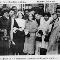 Image of School Field Trip - Students of J. J. Jones High School prepare to board a bus for a field trip. No names are listed.