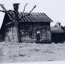 Image of Lester Hill Cabin - Cabin on Cook School Road in Pilot Township.  Lester Hill's grandfather built it in 1812 and , although  in poor condition, it is one of the oldest log cabins still standing in Surry County.