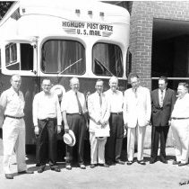 Image of Highway Post Office - Elkin. Highway Post Office serving Elkin - North Wilkesboro.  It replaced Southern R.R. Mail Service when the mail train was discontinued.  Gentlemen standing in front of the new bus are, left to right: Lin Hendren, Postmaster; A. C. Bopst, Asst. Gen. Supt. Postal Transportation Service, Washington; G. D. Martin, District Supt. P.T.S., Greensboro; T. O. Howell, Asst. Dist Supt. P.T.S., Greensboro; Thomas Ashyby, Plstmaster, Mount Airy; Maurice Walsh, Postmaster, North Wilkesboro.  The two men on the far right are not identified.  Aug. 1, 1955.  Picture donated by Lin Hendren.