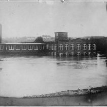 Image of 1916 Flood - Elkin.  1916 flood.  The Chatham Manufacturing Company building  is submerged in water.  Picture donated by Una Norman Key.
