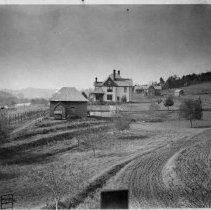 Image of R. L. Hubbard Home - Elkin.  R. L. Hubbard home, Surry Avenue, about 1900.  The Yadkin River can be seen in the background.  Picture from the Roth Collection.